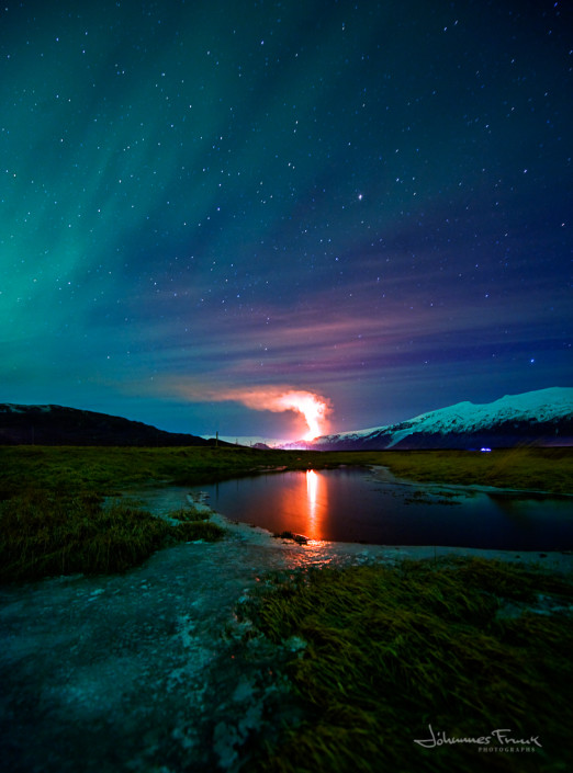 Glacier Myrdalsjokull and volcano with Northern Lights Johannesfrank