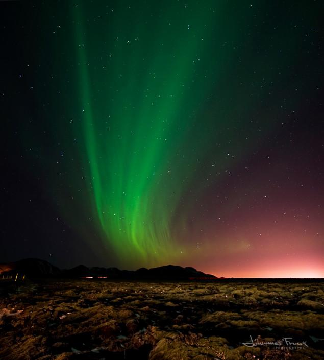 Northern Lights shining over Bláfjöll Bluemountains in Iceland
