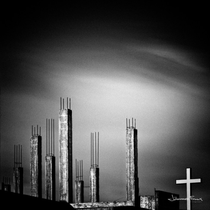 Cross and unfinished building Johannes Frank