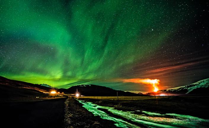 Aurora Borelis (Northern Lights) shine over the Volcano eruption at Myrdals Clacyer