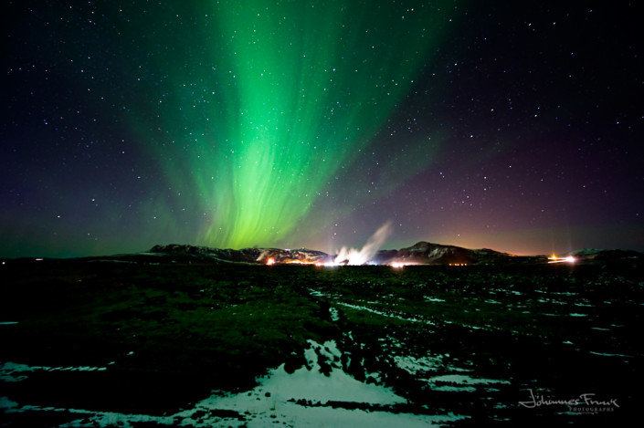 A powerfloul Northern Lights shine over the Hellisheidar Power Plant