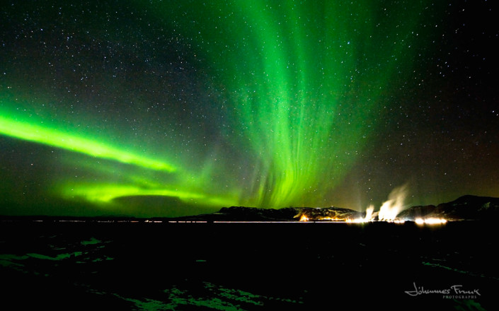A Powerful Northern Lights shine over the Hellisheidar Power Plant