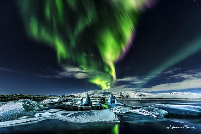 Northern lights shine over the Glacier Lagoon