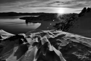 Kleifrvatn Winter Sun lo on the horizon johannes frank