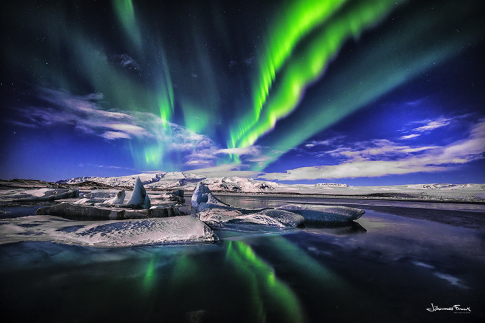 Northern lights shine over the Glacier Lagoon