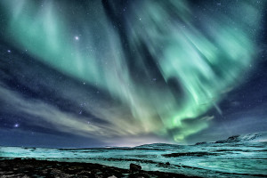 Northern Lights shining, shoot on the mountain roat to Þingvellir National Part in Iceland. (Johannes Frank)