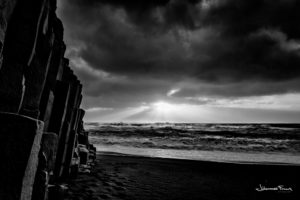Reynisfjara beach and columnar rocks and sun rays johannes frank
