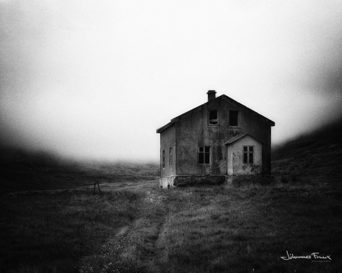 Heavy fog behind abandoned house Patreksfirði johannes Frank