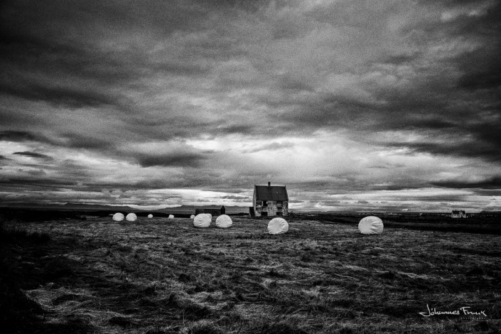 White hay balls and abandoned house johannes frank