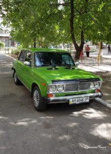 Green Lada in a park in Mariupol johannesfrank
